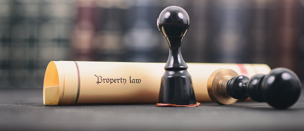 Property Deed symbolizing real estate law